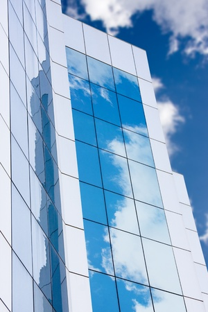 Modern office building exterior with sky reflection. Stock Photo