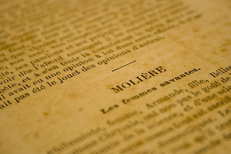 Sepia toned close-up of very old french book page. Shallow depth of field. Stock Photo
