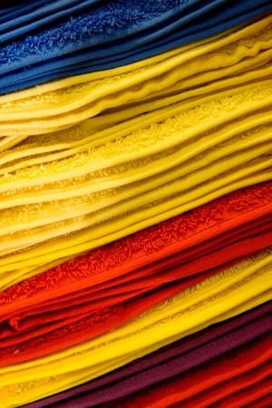 A stack of towels with different colors.