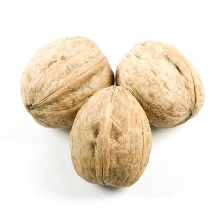 Three walnuts isolated on white.