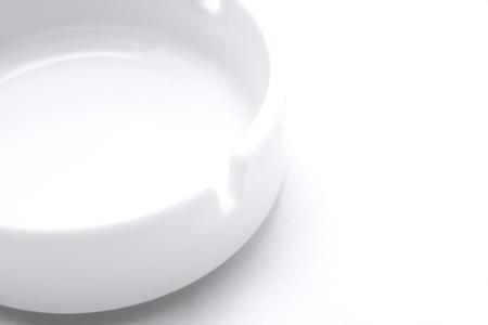White ashtray on white background.