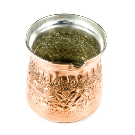 Copper pot isolated on white background.