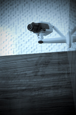 Blue toned security camera mounted on a wall. Focus is on camera. Stock Photo - 11084091