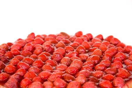 Strawberry cake closeup shot isolated on white.