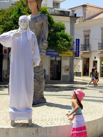 immobility: man-statue in a street of the city of lakes in portugal algarve region