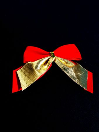 A fancy red bow designed with stars. photo