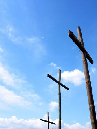 redemption: Three crosses wooden with blue sky in deep     Stock Photo