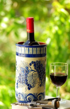 Glass and bottle of red wine produced in the region Alentejo, Portugal