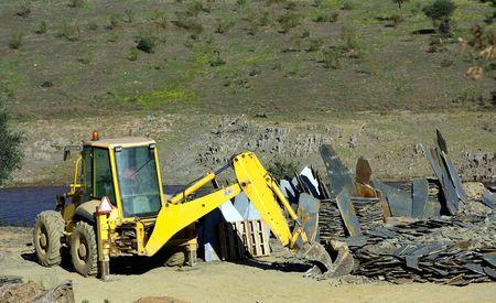 yelow:  Yelow excavator bulldozer in quarry