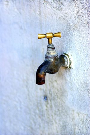 seeping: Old brass dripping faucet,Dripping Tap.
