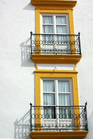 Two windows in fa�ade of building in Portugal. Stock Photo - 2712149