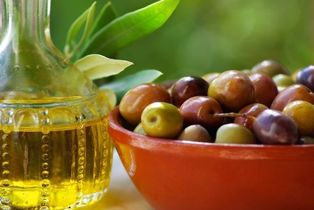 Portuguese oil and mature olives. photo