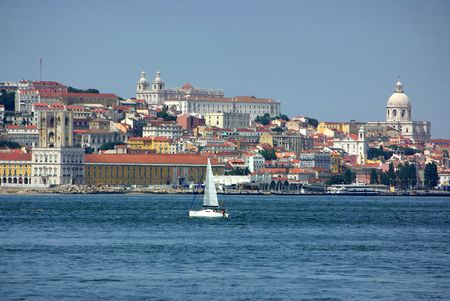 Panoramic of Lisbon with boat in the river Tejo. Stock Photo