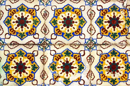 regular: Old  and colored tiles  in a Portuguese wall. Stock Photo