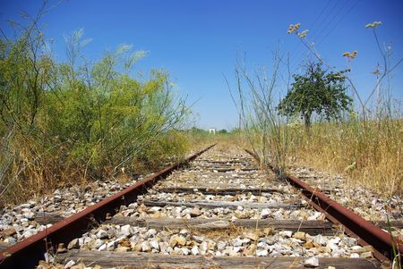 Old railway track in the plain,Portugal. photo