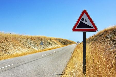 Roadsign on the inclined road. photo