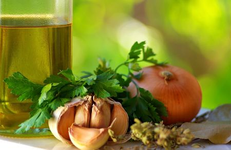 Olive oil and food ingredients. photo