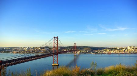 The 25 de Abril Bridge is a suspension bridge on river Tejo, Lisboa. Stock Photo - 3835973