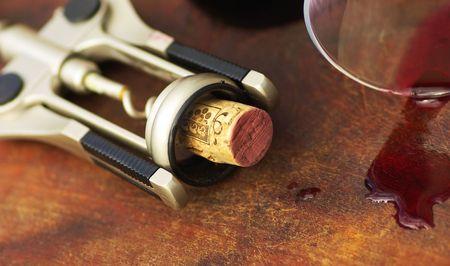 Red wine and cork closeup. Banco de Imagens