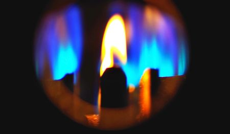 Inflammable fire of the gas in a deep black. photo