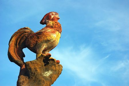 Rooster in a wooden post. photo