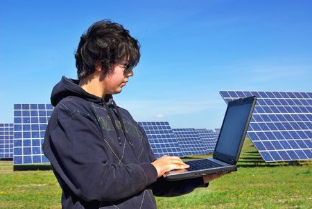 Young man in Central of photovoltaic panels. photo
