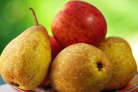 rocha: Portuguese Rocha Pear and red apple.