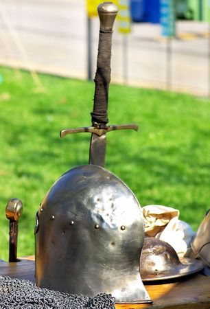 Medieval helmet and swords. Stock Photo - 4899035