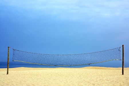 Volleyball net on the portuguese beach. photo