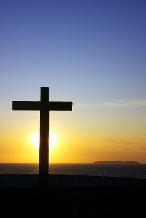 Cross of Christ to the Sunset. Stock Photo