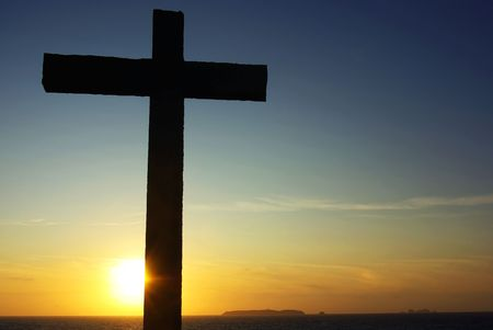 Cross of Christ to the Sunset. photo