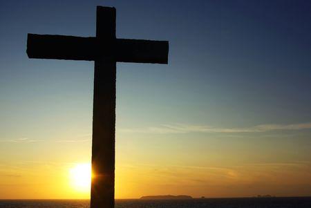 Cross of Christ to the Sunset. Standard-Bild