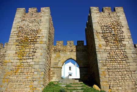 crenelation: Portuguese Church and castle.