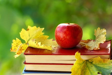 Red applle and books. photo