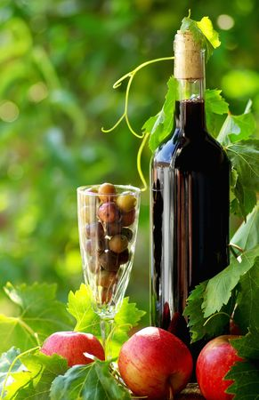 Red wine and fruits photo