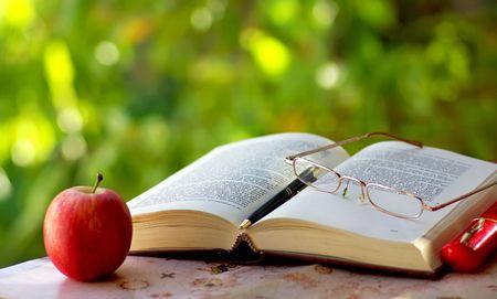 Old book, pen  and glasses. Standard-Bild