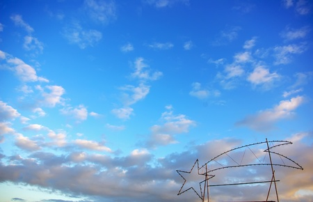 Christmas star in  blue sky. photo