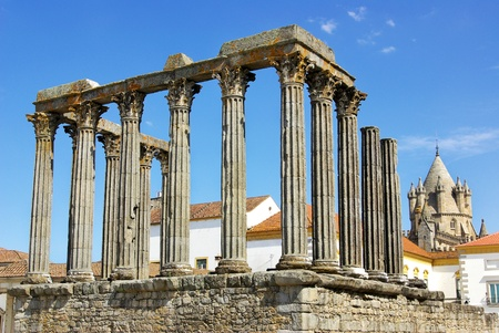 Roman temple and cathedral tower of Evora, Portugal.