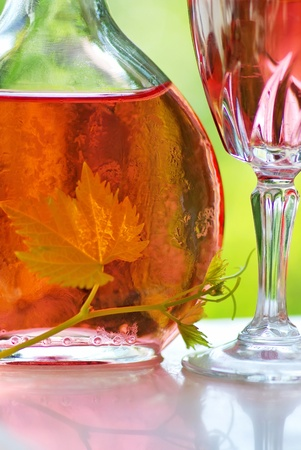 Glass and bottle of rose wine Stock Photo - 9870729