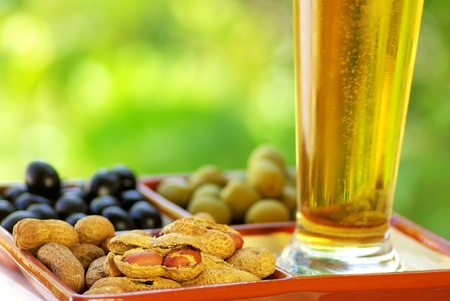 beer glass with peanuts and olives Stock Photo - 9870674