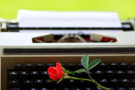 Red rose on  keyboard of old Typing machine  photo