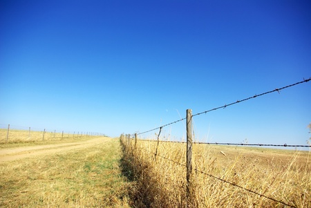 Barbed wire fence with blue sky at Portugal. photo