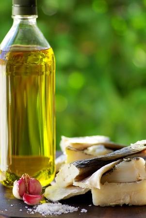 Codfish, oil and garlic. Фото со стока