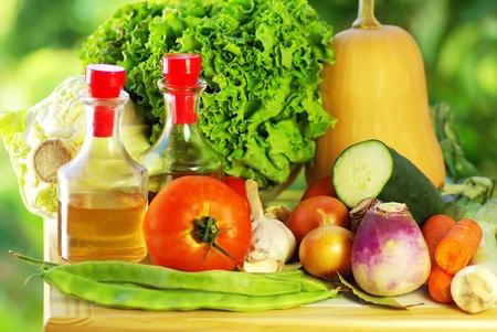 Oliveoil,vinegar, and vegetables photo