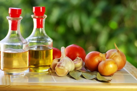 Oliveoil, vinegar and vegetables. Stock Photo