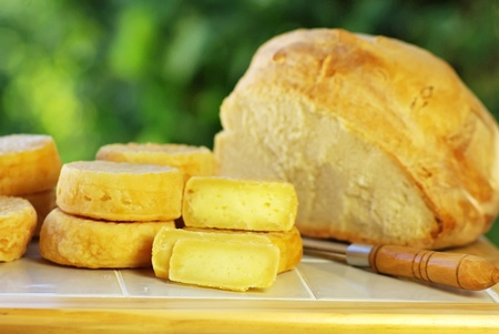 Portuguese cheese, knife and bread. photo