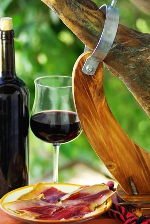 Spanish Jamon  and red wine. photo