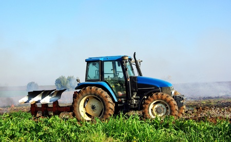 agriculturalist: Blue tractor in portuguese field Stock Photo