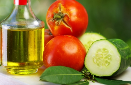 Olive oil, tomato and cucumber photo