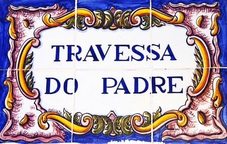 street name sign: Portuguese tile plaque on street